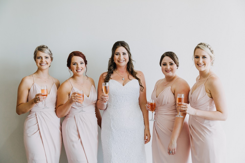 Bride and Bridesmaids with champagne