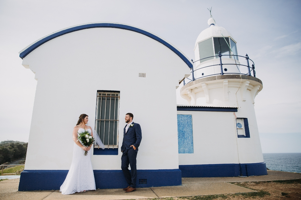 Bride and Groom looking at each other in front of Tacking Point Lighthouse Port Macquarie