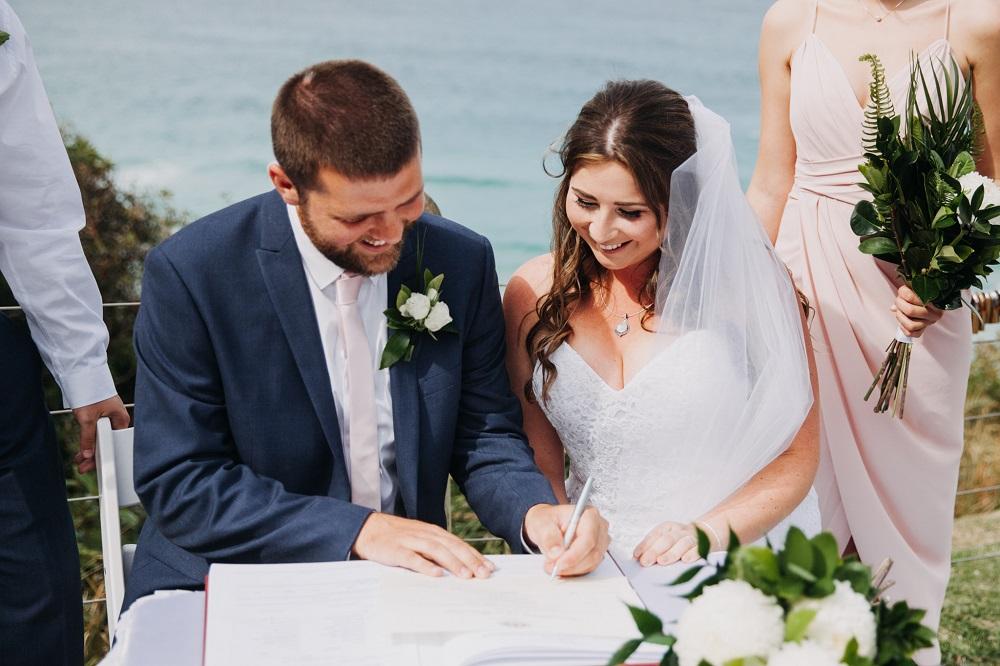Couple signing wedding register