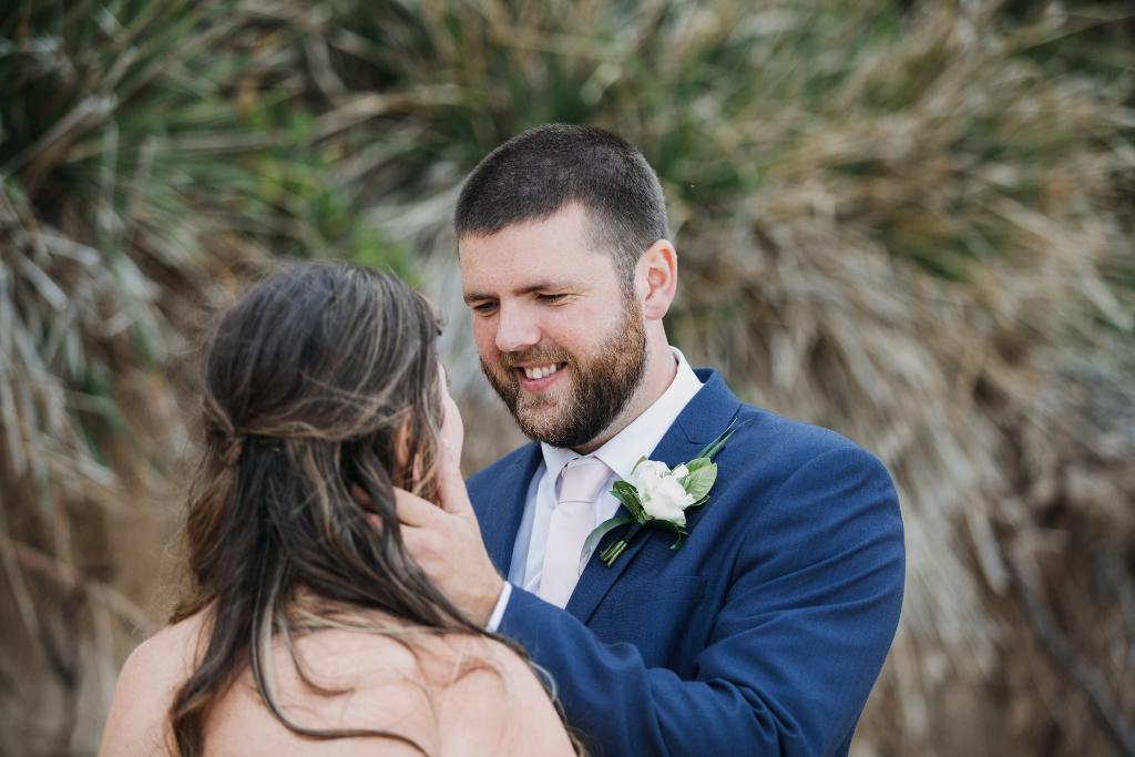 Groom looking into Bride's eyes