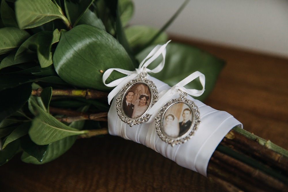 Wedding family charms on bouquet