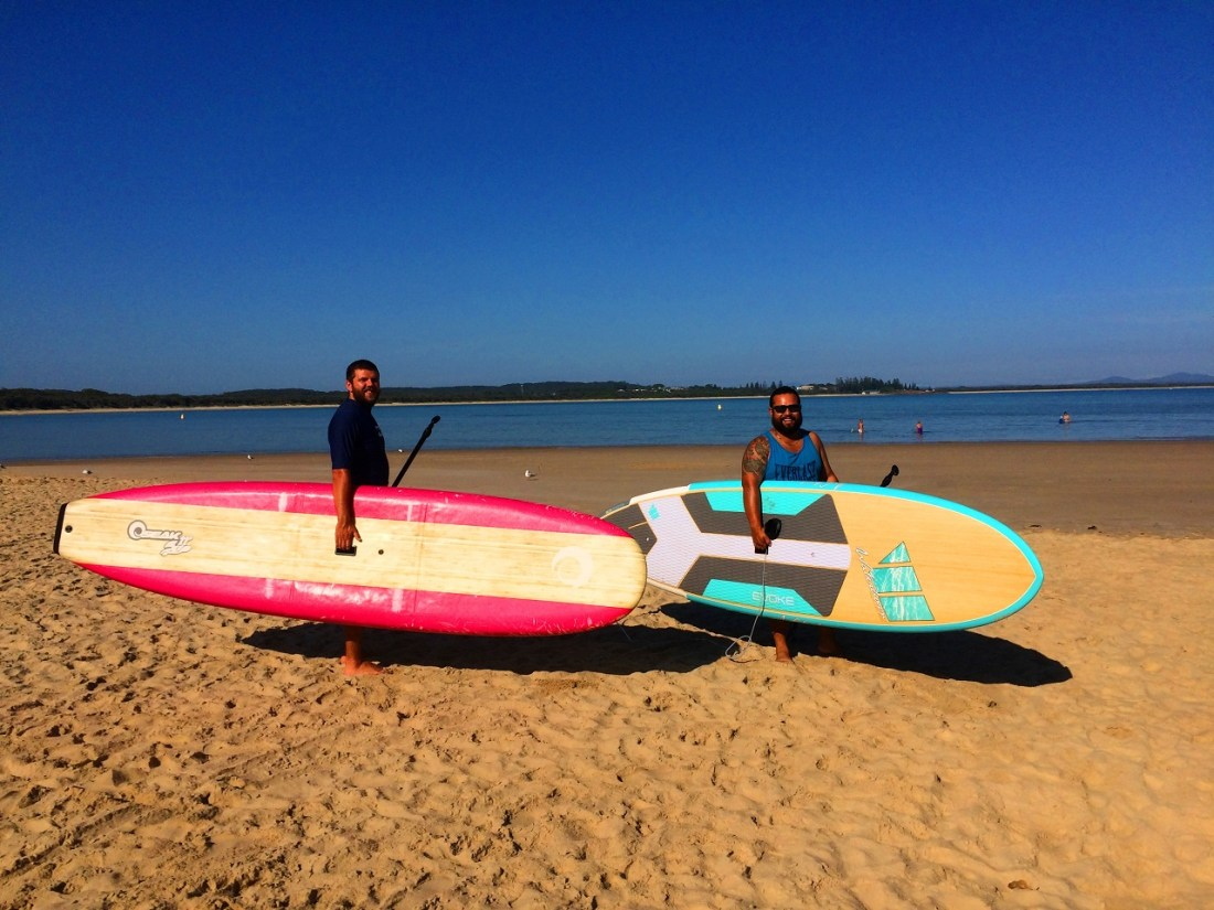Boys with stand up paddleboards