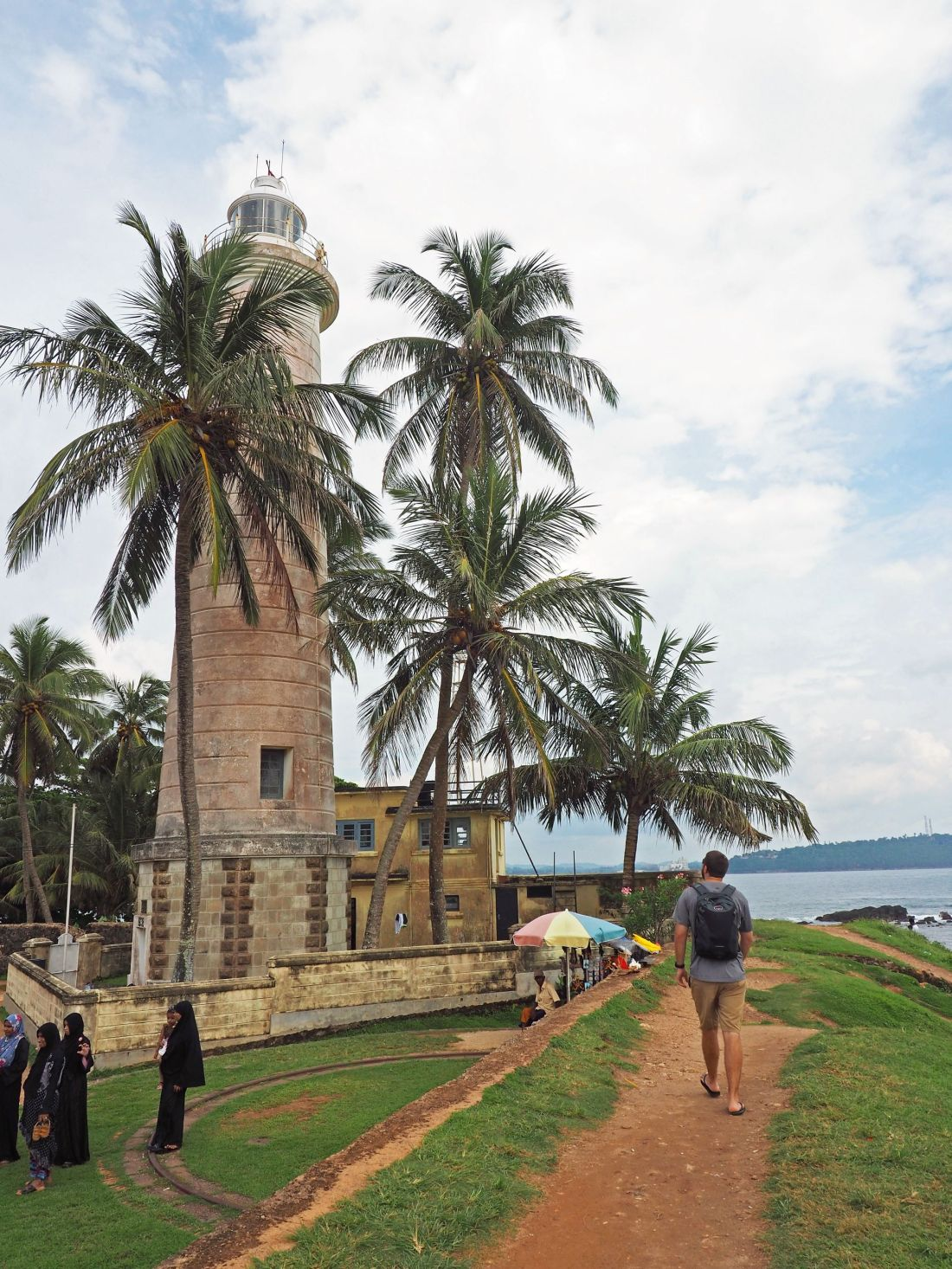 Boy looking up at Galle Lighthouse