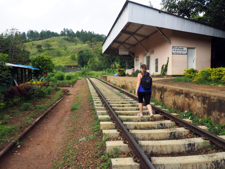 Girl Walking along train tracks Sri Lanka