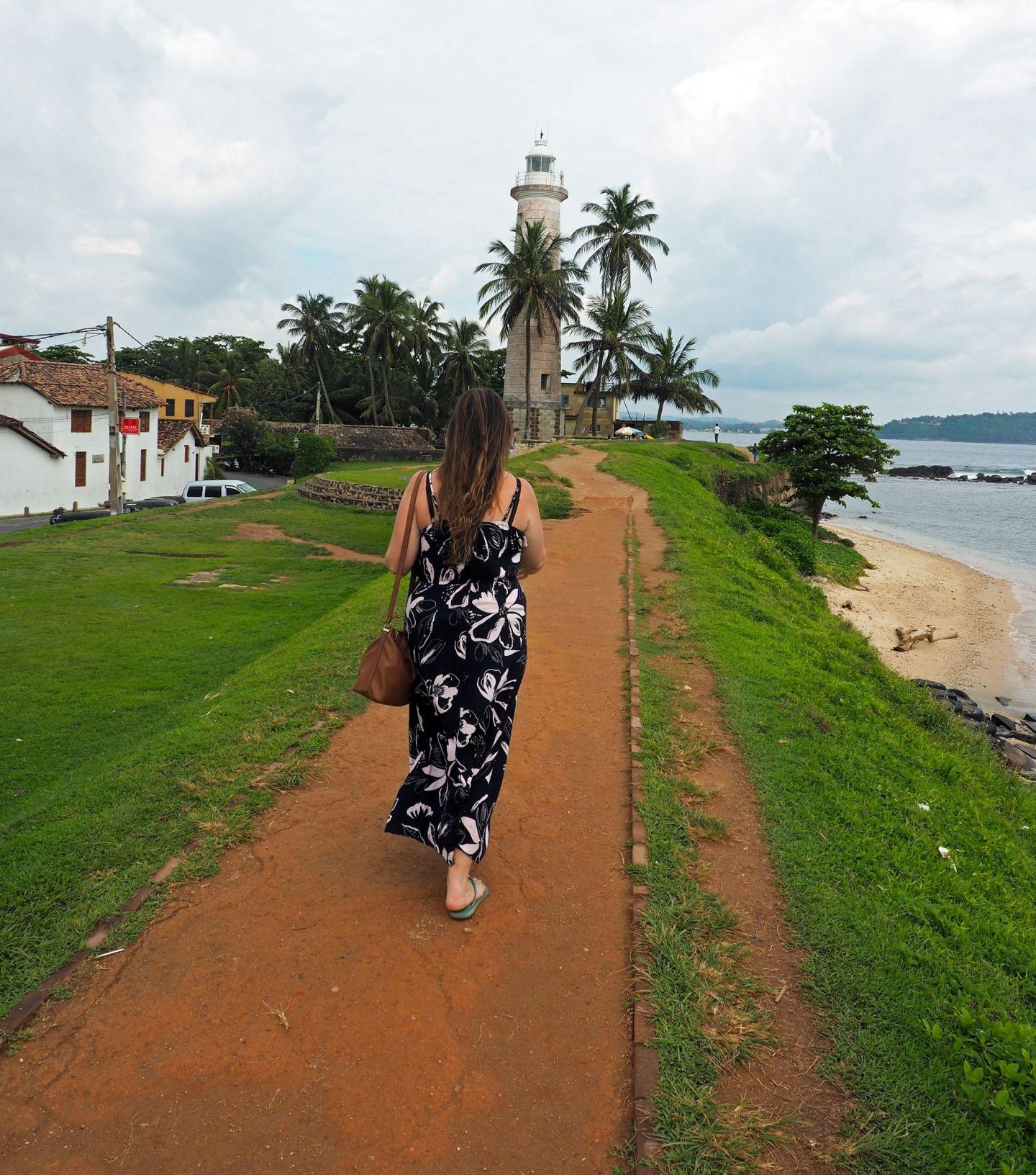 Girl walking towards Galle Lighthouse