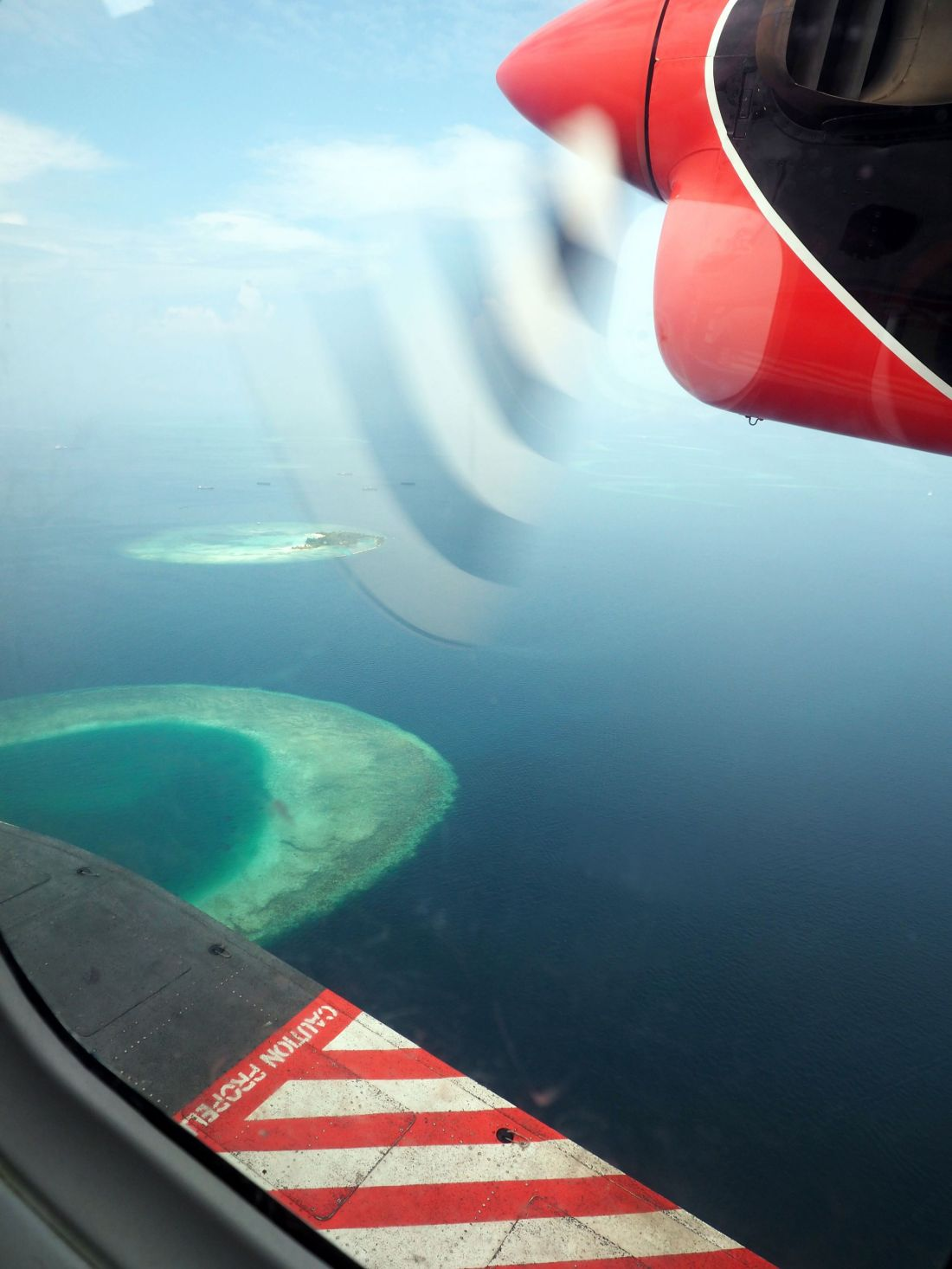 Flying over Atolls in Maldives