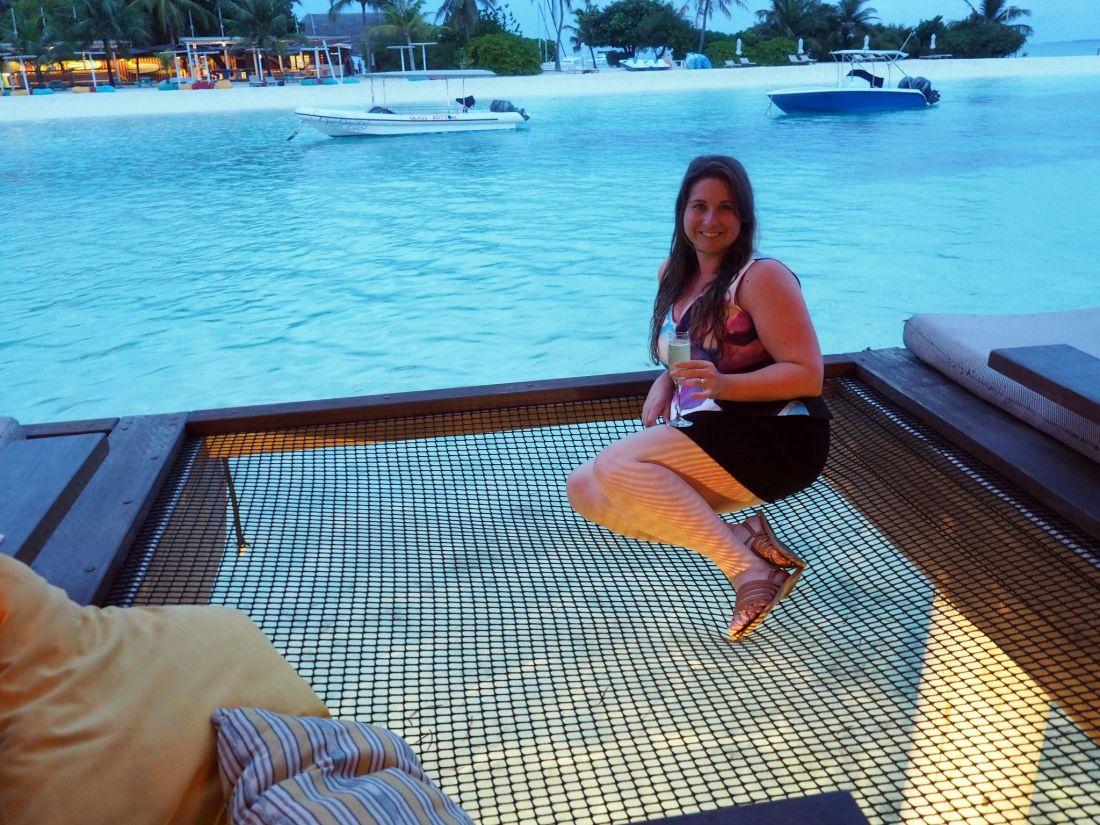 Girl on overwater nets Maldives