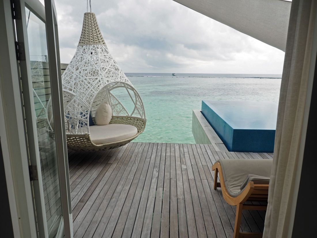 Looking out from villa to deck and pool LUX Maldives