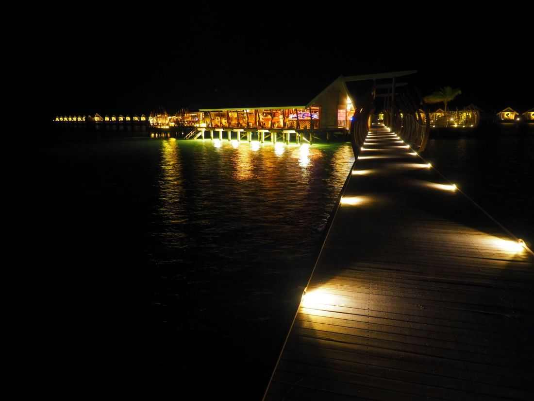Night walkway to East Market LUX Maldives