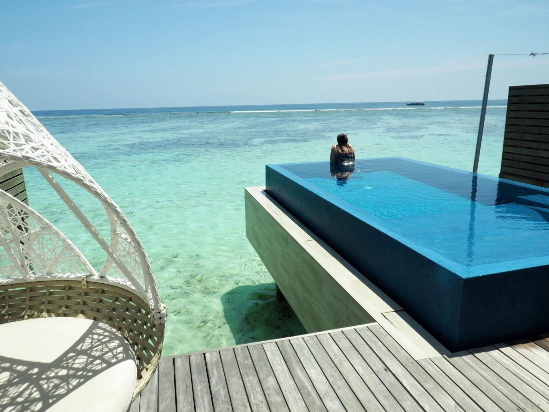 Simone relaxing in Overwater Bungalow Infinity Pool LUX Maldives