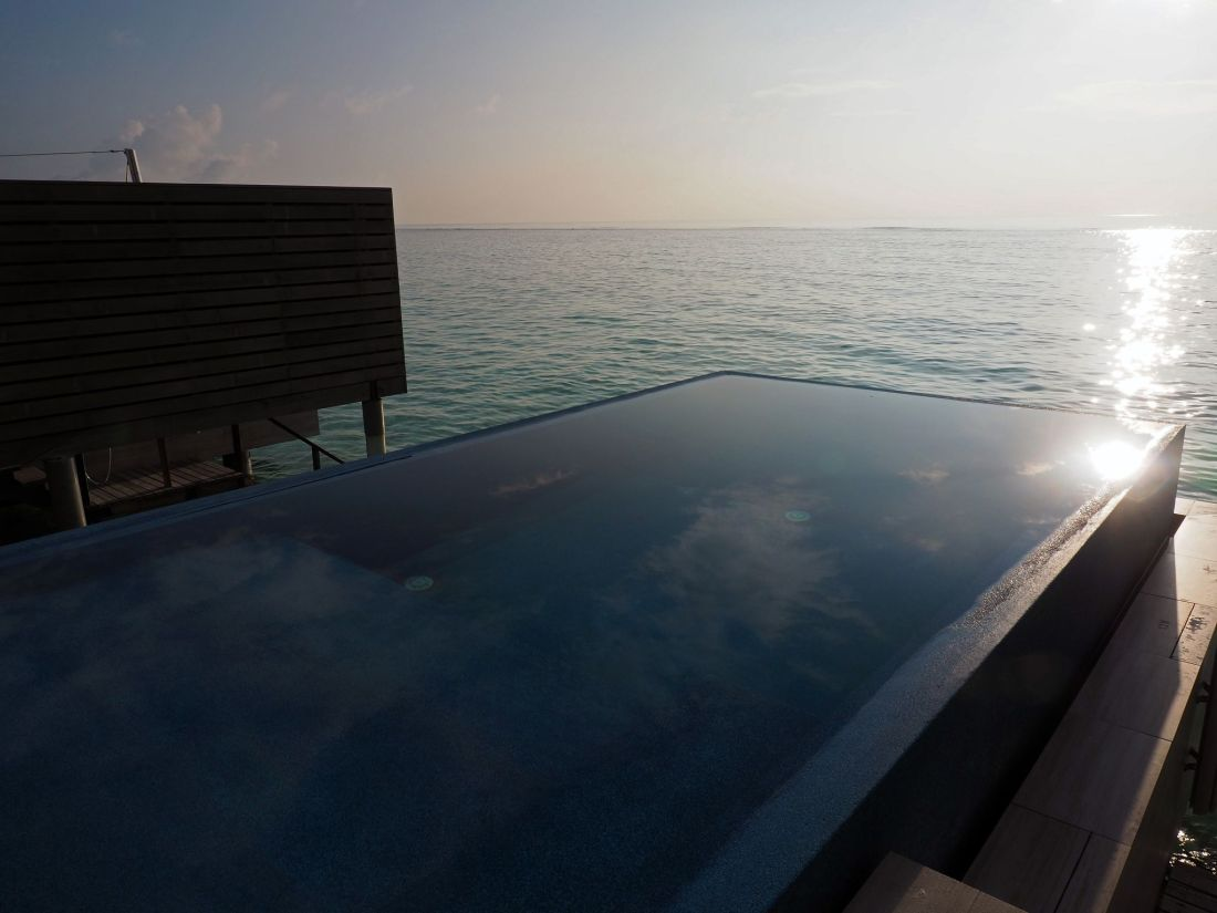 Sunrise over infinity pool LUX Maldives