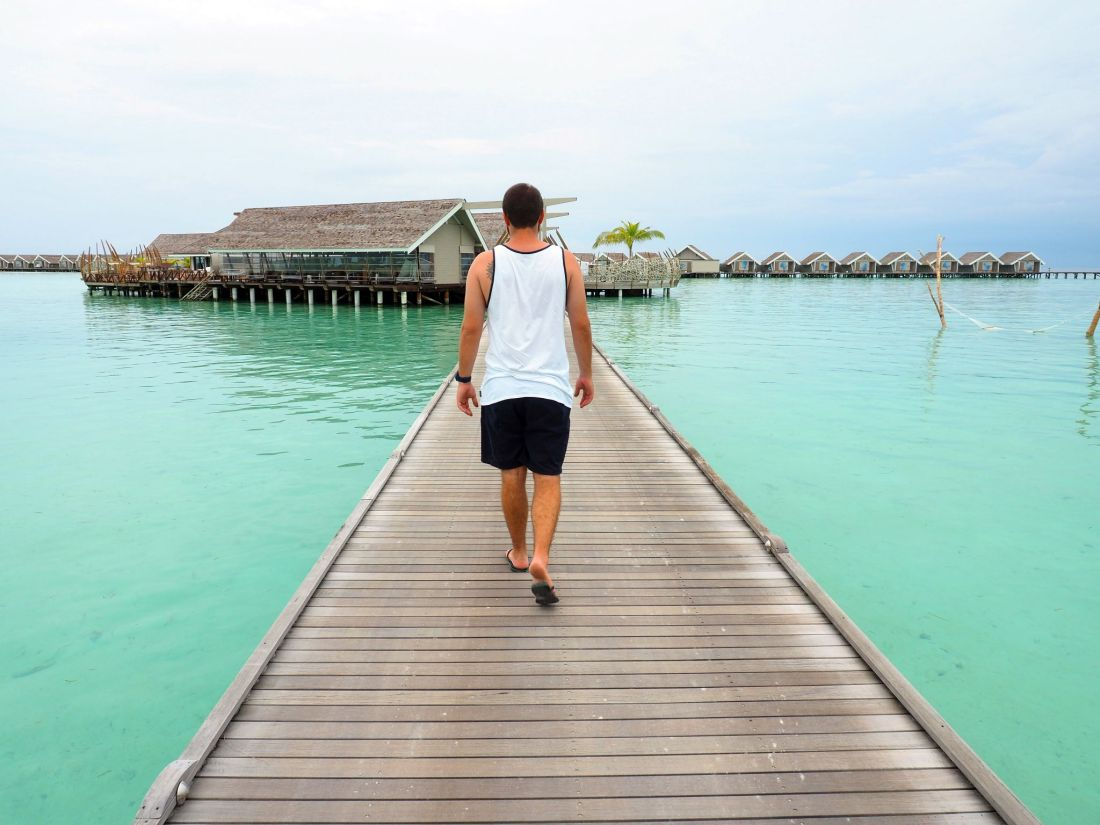 Walking to overwater bungalows LUX Maldives