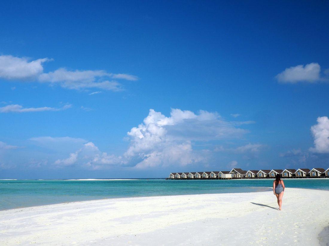 Simone walking on sandbar in Maldives