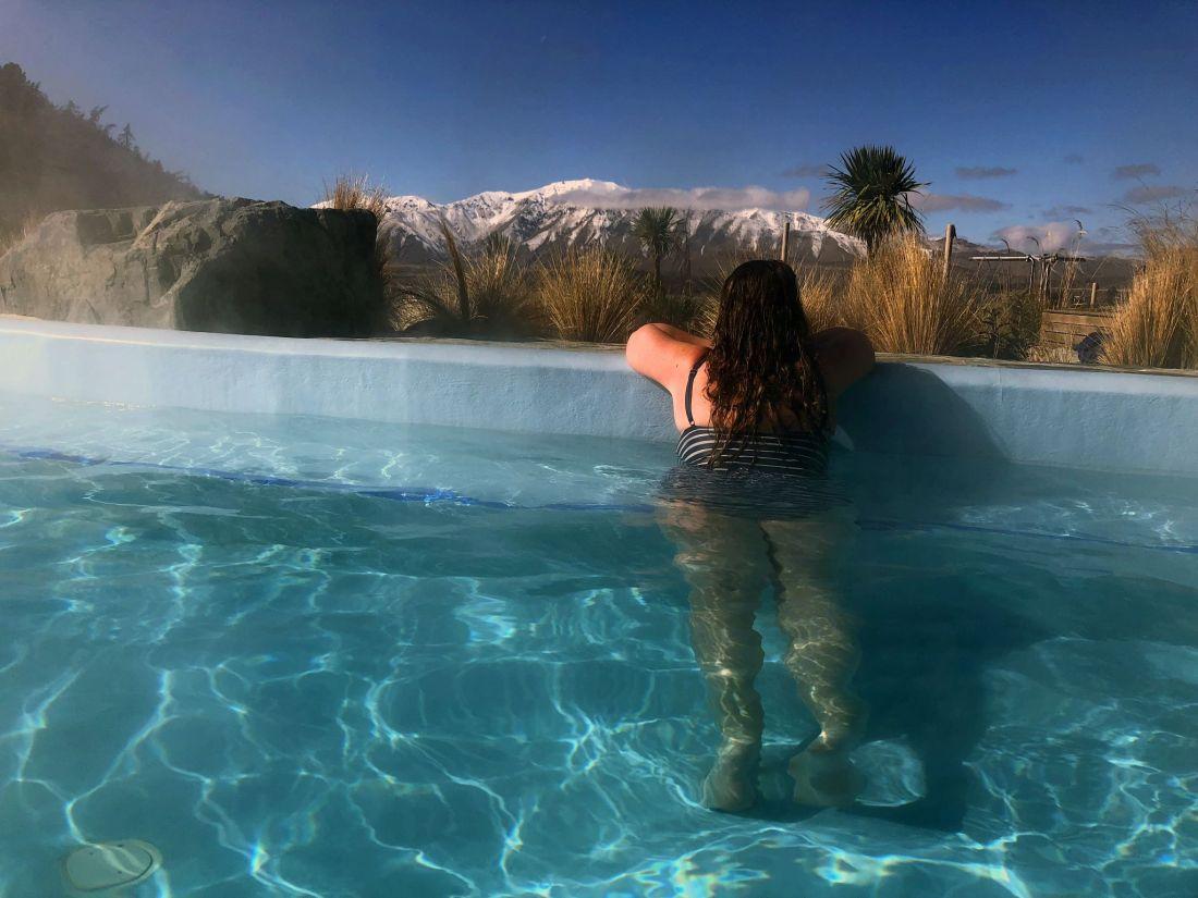Simone overlooking snowy mountains at Tekapo Hot Springs