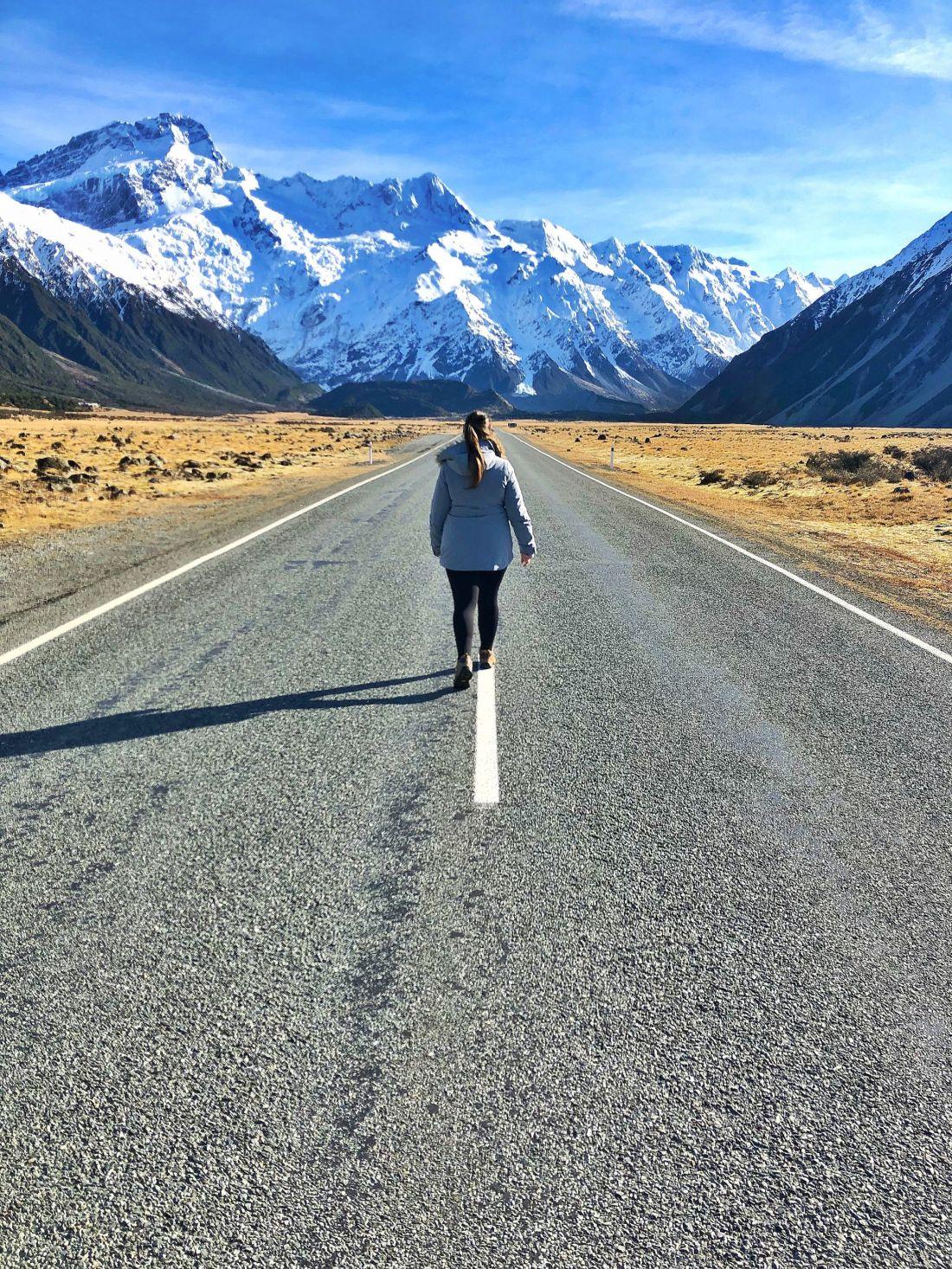 Simone walking road to Mount Cook Village