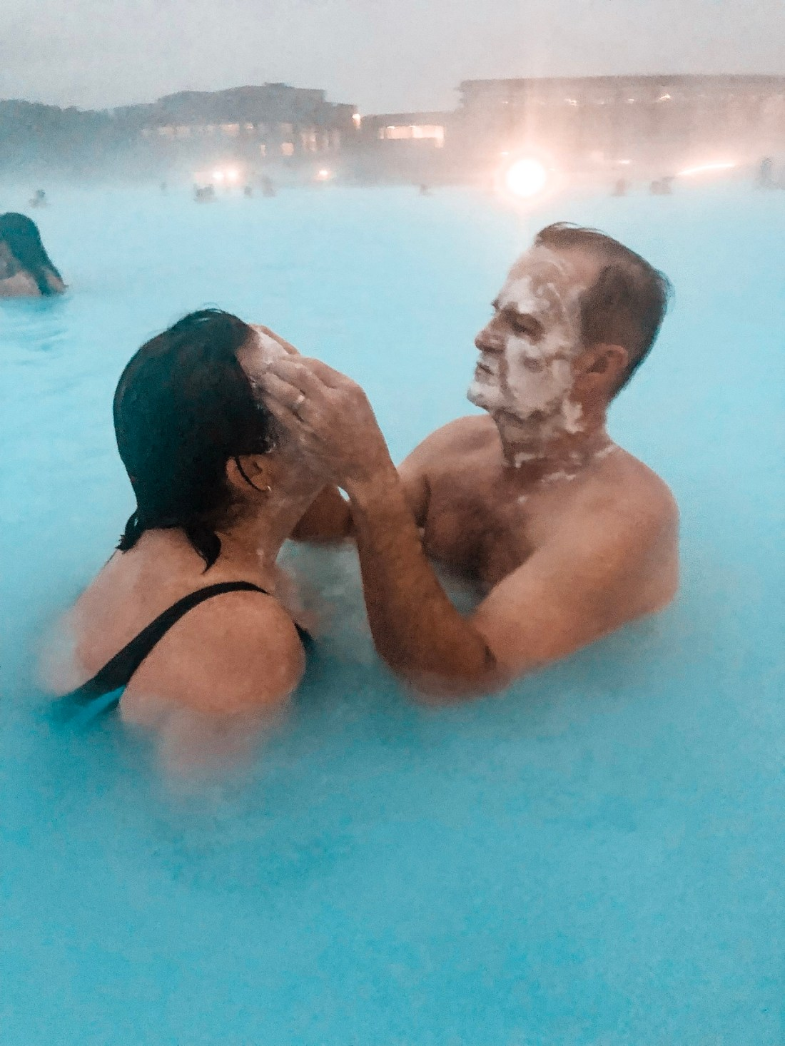 Putting masks on in Blue Lagoon