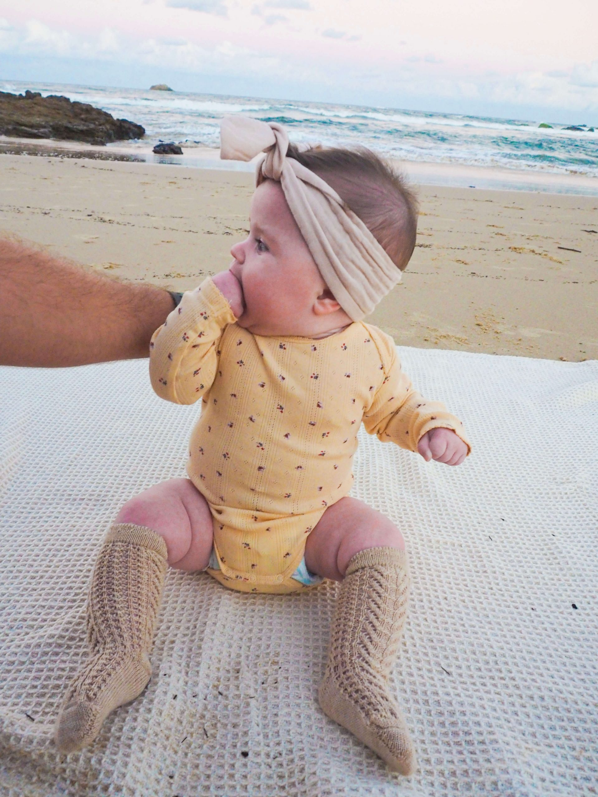 Addie-in-Elves-in-the-Wardrobe-Baby-Clothes-at-beach