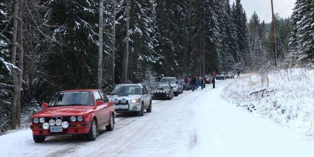 The winning BMW 325IX joins other cars waiting to start a regularity (timed section) on the Thunderbird Rally. Credit: