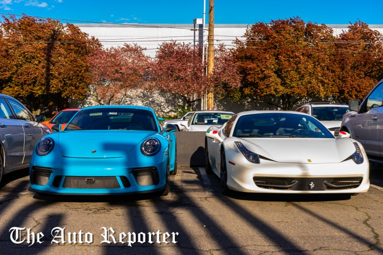 Ferrari and Porsche outside the Beauty & Key's launch at The Shop - The Auto Reporter