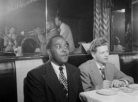 Charlie Parker and Red Rodney listening to Dizzy Gillespie, Marjie Hyams, and Chuck Wayne, Downbeat, New York, 1947 (Photograph by William P. Gottlieb)