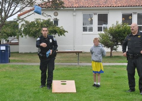 Officer Guydan wins bean bag toss.