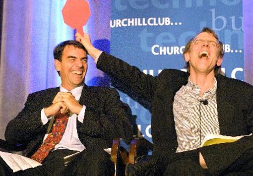 Draper and fellow venture capitalist Doerr amuse each other at a venture capitalist event