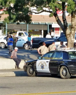 According to a witness, the first to be handcuffed was the man in the white hat. (Image provided by a reader.)