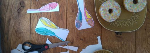 cutting out Free printable boho feathers pdf for a doughnut party diy craft