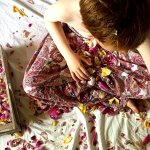 boy on a bed doing a flower play sensory activity