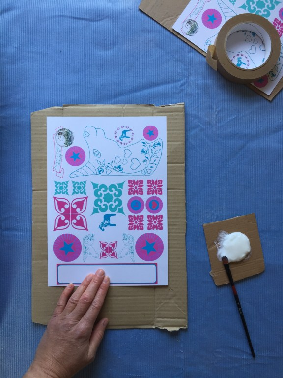 glue your free unicorn kids craft printable to your kids cardboard art for making junk necklaces with children