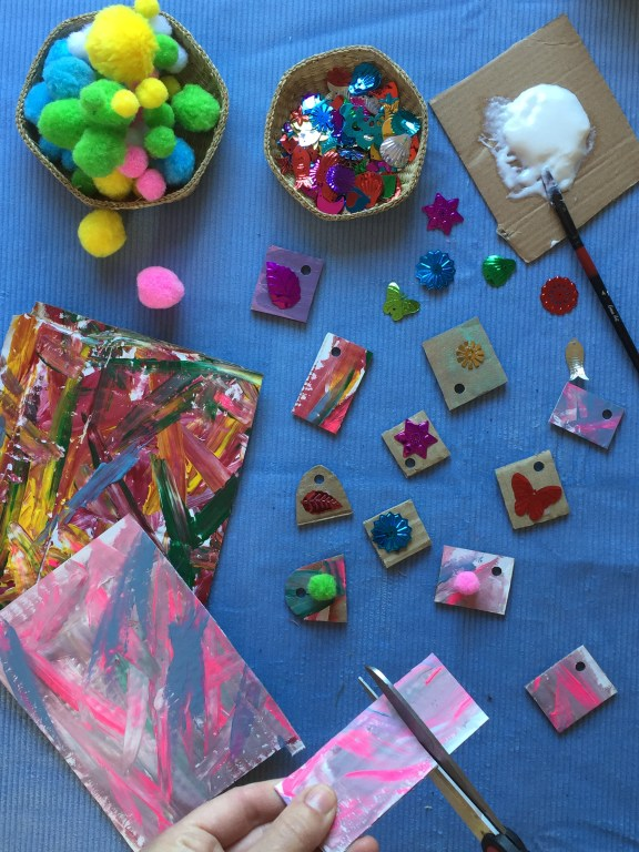 kids create colourful and eco friendly necklaces from cardboard shapes, paint, sequins and nature