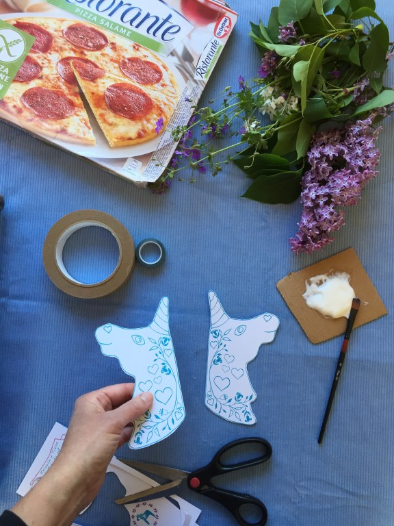 cut out the large unicorn shapes from our free unicorn printable kids craft
