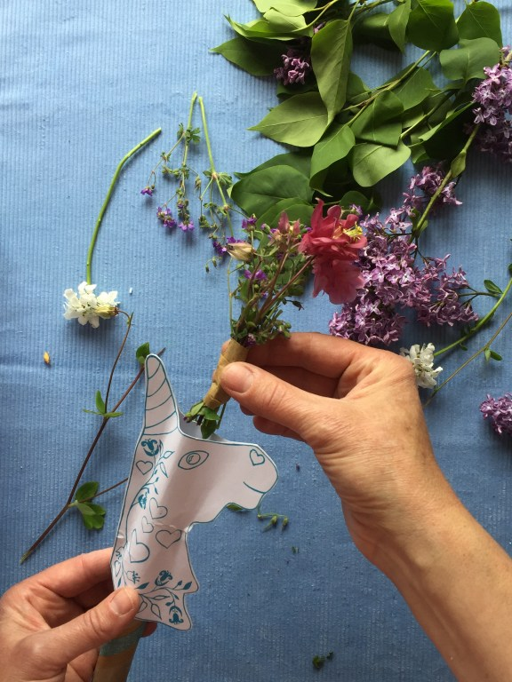 decorate your unicorn wand with flowers and foliage from the garden