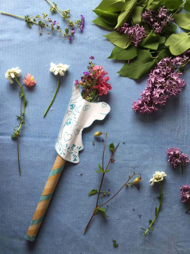 make an eco unicorn wand from a recycled pizza box and nature from your garden