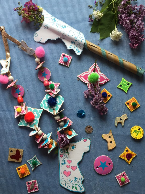 a colourful childrens unicorn wand and necklace set - a recycled cardboard kids craft made with our free unicorn printable