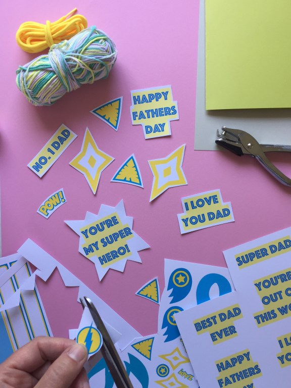 cut out the superhero shapes from our free printable and start creating your homemade fathers day card