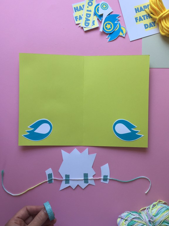 stick some cute super hero shapes to the string with cellotape on your  homemade fathers day card to create the pop up effect