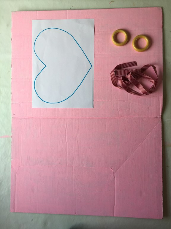 make your parlour from a cardboard box, ribbon and curtain rings!