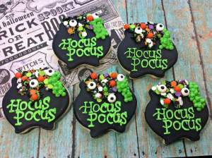 Hocus Pocus Potion Sugar Cookies are adorable witches cauldron's overflowing with Halloween delights. Perfect for Trick or Treat.