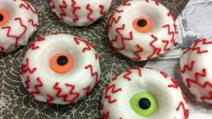 Halloween candy coated monster eye donuts