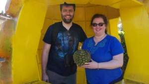 Visiting the Dole Plantation on Oahu, Hawaii. Taking a photo inside of their fake pineapple.
