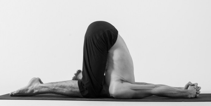 Karnapidasana yoga pose