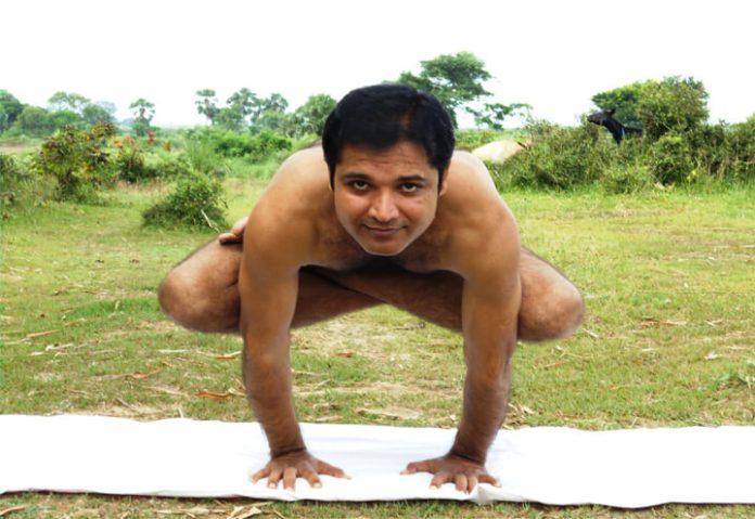 Kukkutasana yoga pose