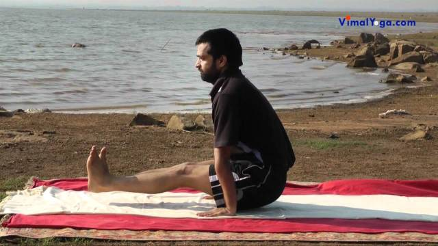 Tolangulasana yoga pose