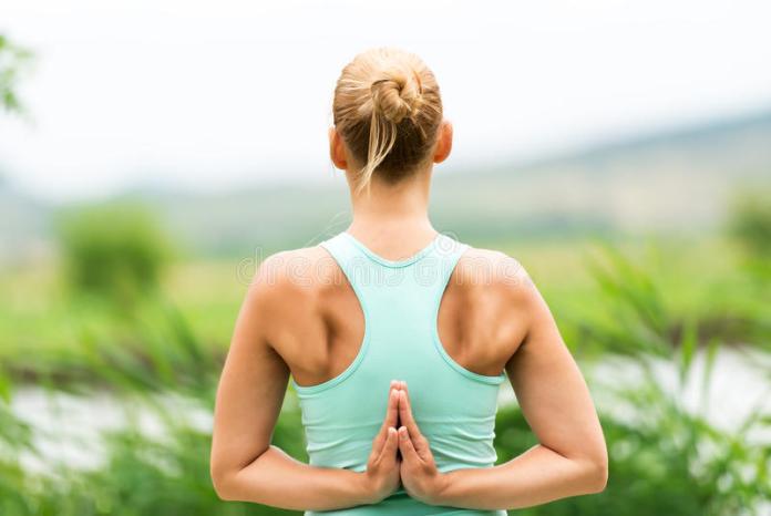 reverse prayer yoga pose