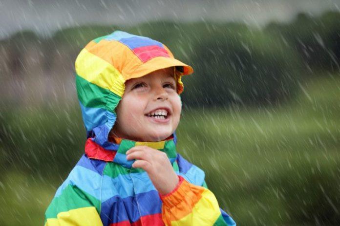kid enjoying the rain