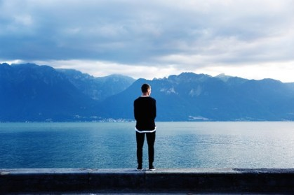 man gazing mt lake