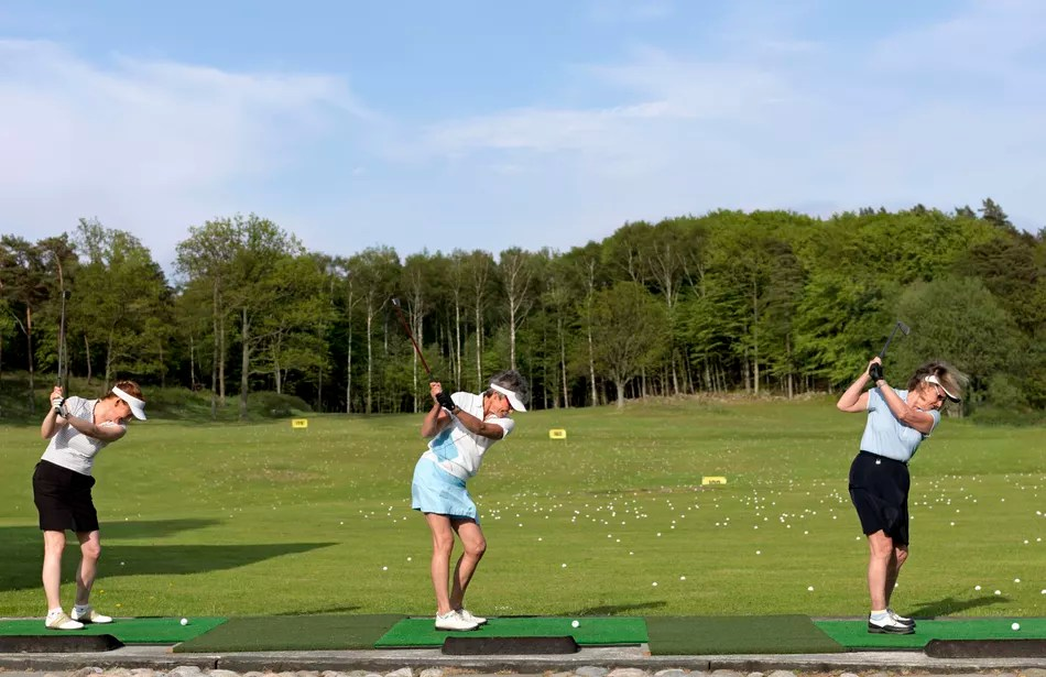 Three ladies at a driving range