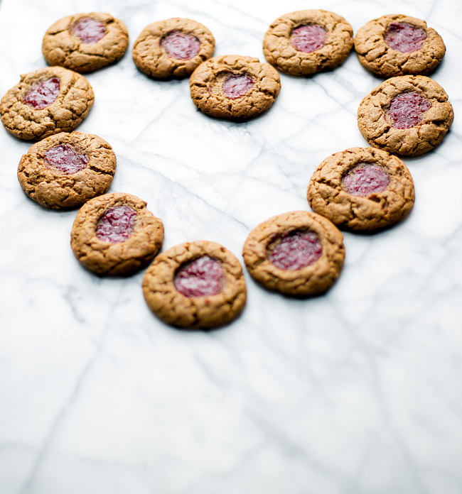 Gluten free peanut butter cookies with a kiss of jam right in the middle. Only requires six ingredients, and comes together in one bowl!