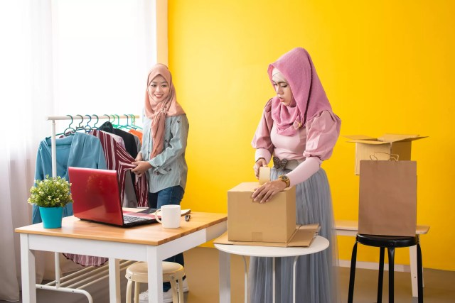 Two young Muslim women with hijab on small business startup and work at home for online retail store